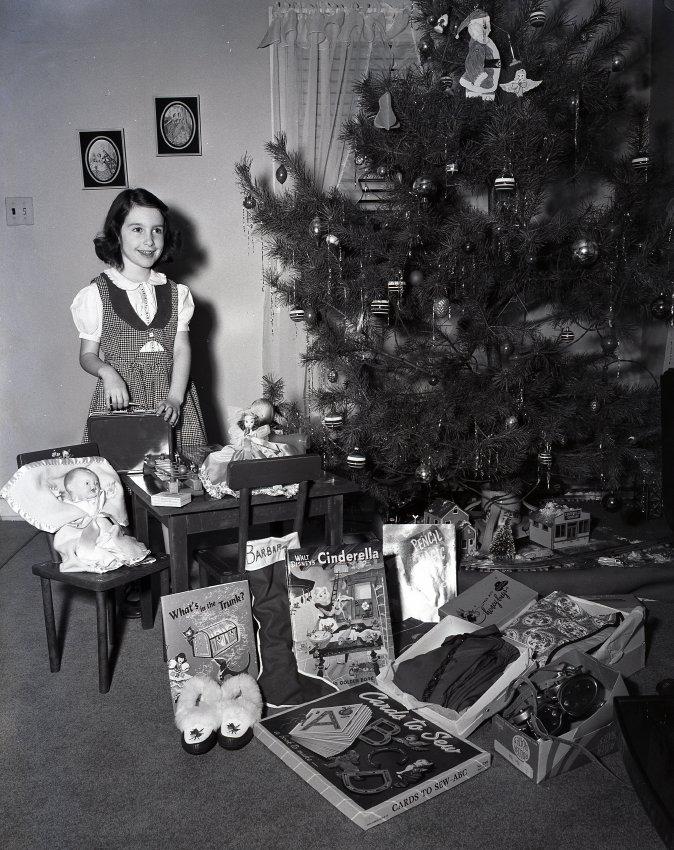 Girl with presents and Christmas Tree